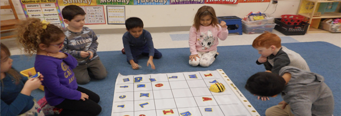 Students working with BeeBots in a group picture