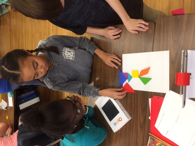 Student using Osmo