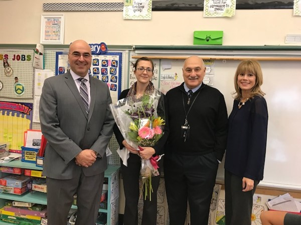 From left: David Rennie, Principal; Jessica Ging, Teacher of the Year for the Caldwell Elementary School; Michael Davino, Superintendent; Erica Scudero, Director of Curriculum, Assessment and Instruction
