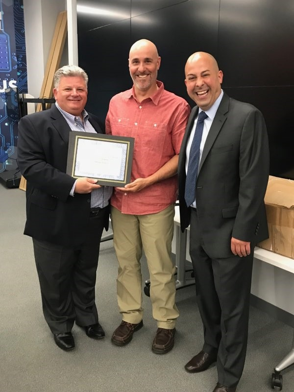 From Left: Scott Silverstein - Board President, Anthony Scarpelli - Teacher of The Year and Michael Plias - Principal, Thelma L. Sandmeier Elementary School