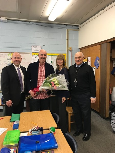 From left:  Michael Plias, Principal; Anthony Scarpelli, Teacher of the Year for the Sandmeier School; Erica Scudero, Director of Curriculum, Assessment and Instruction; Michael Davino, Superintendent.